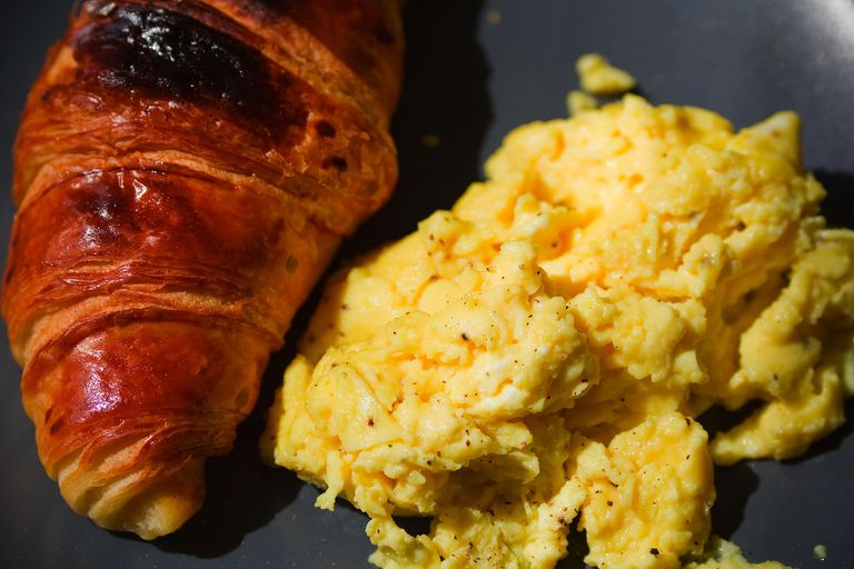 Scrambled eggs and croissant