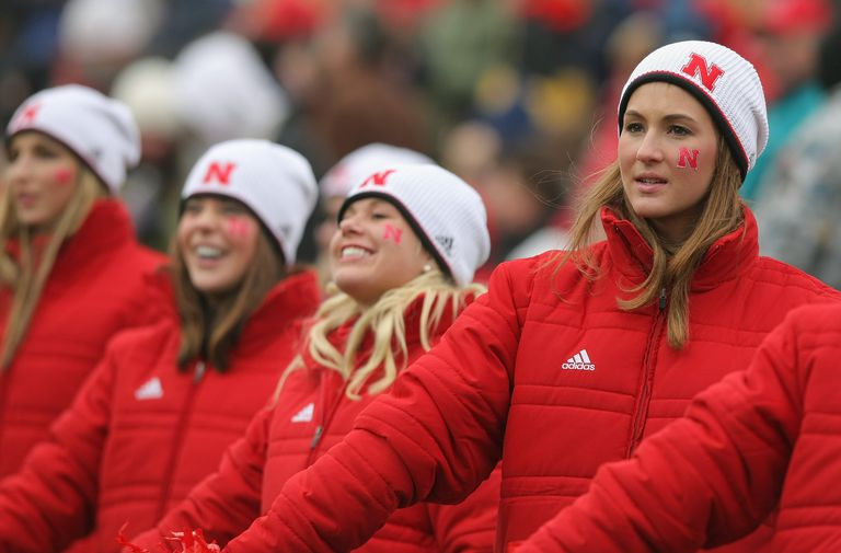 Cheerleaders of the Nebraska Cornhuskers cheer against the Colorado Buffaloes during Big 12 College Football action at Folsom Field on November 23, 2007 in Boulder, Colorado.