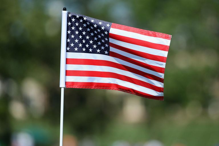 CHARLOTTE, NC - MAY 04: The American National Flag is used as the pin flag on the 17th hole during the final round of the Wells Fargo Championship at the Quail Hollow Club on May 4, 2014 in Charlotte, North Carolina.