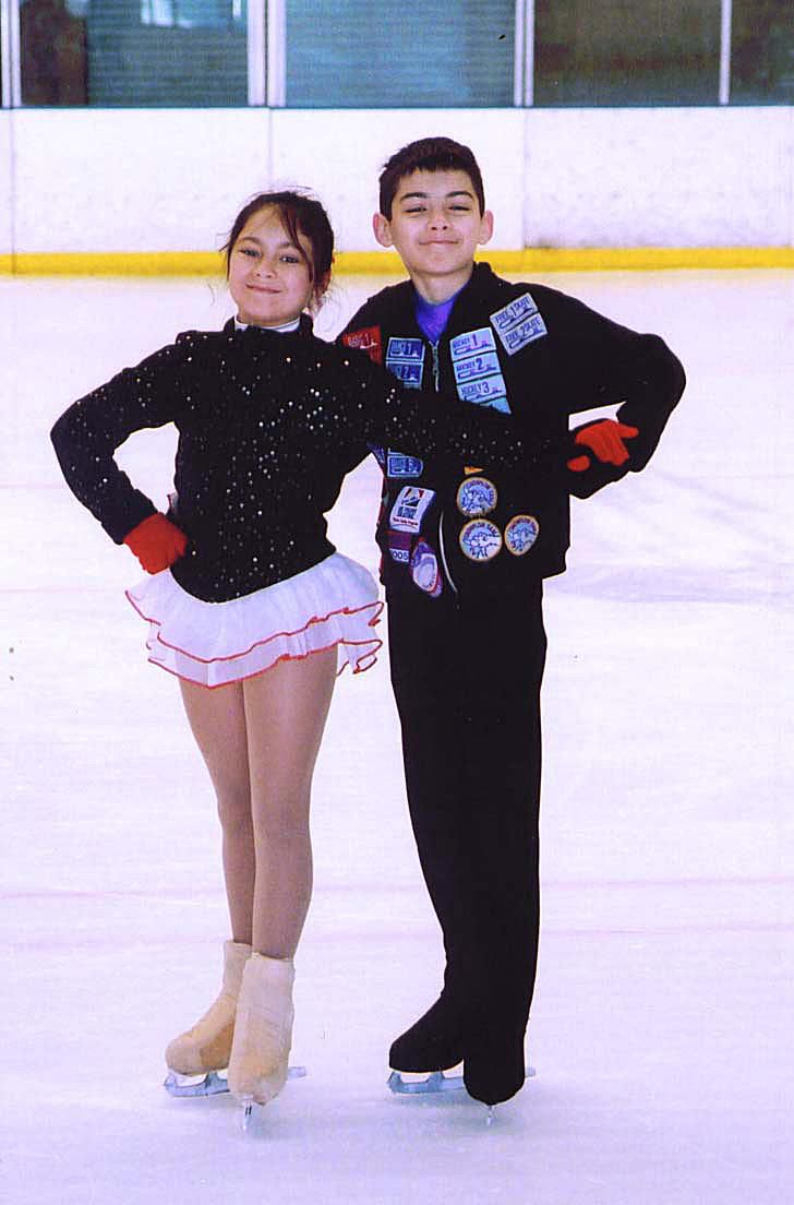This is Killian Position, one of the basic skating positions in both ice dancing and pair skating.