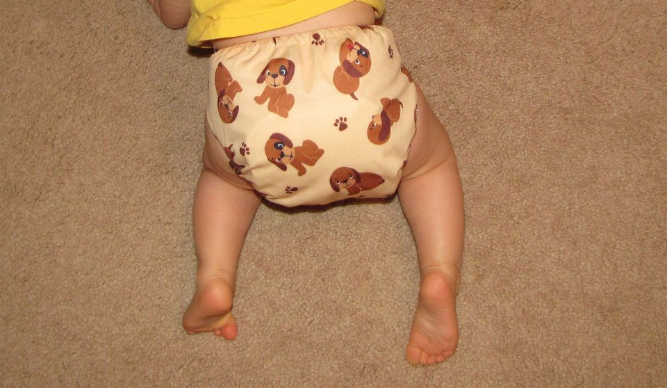 A picture of a baby in a Happy Heinys cloth diaper