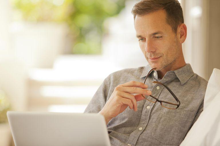 Pensive man using laptop