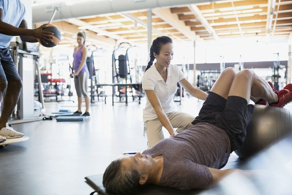 Physical therapist working with a patient.