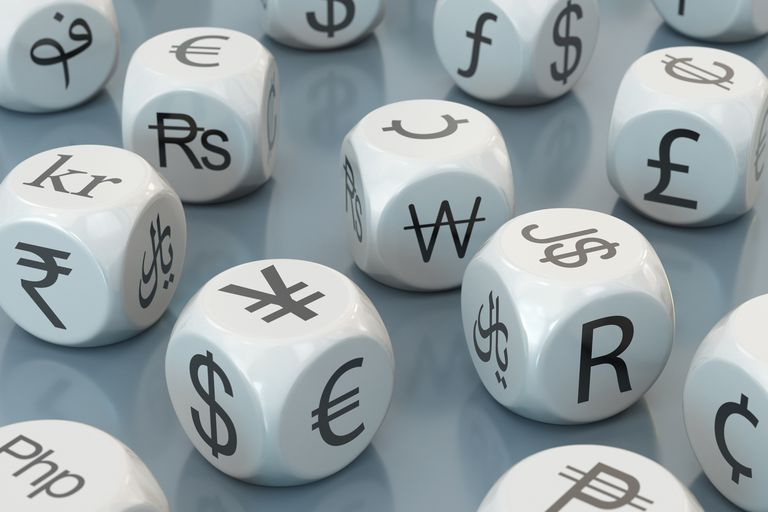 Many dice with currency symbols