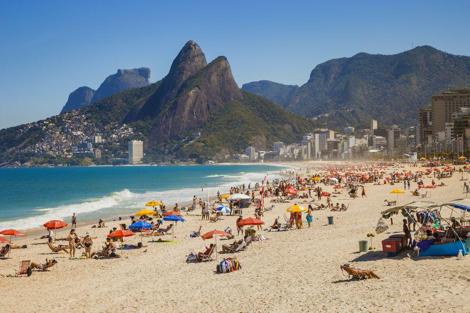 The crowds enjoy the picturesque beach in Rio de Janeiro