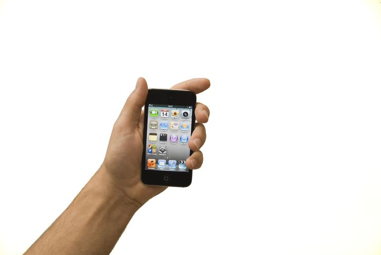Close-up of man's hand holding iPod Touch