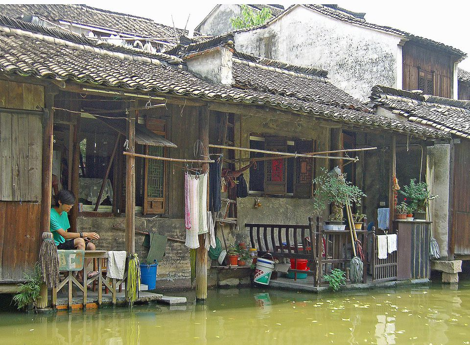 Living in a centuries-old home above one of the canals in Wuzhen, China