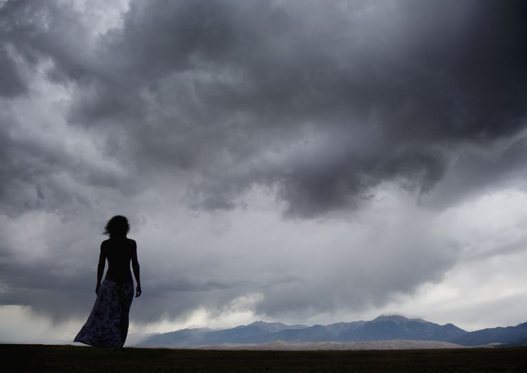 Woman watching a storm