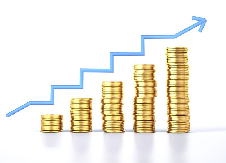Gold coins and a growth chart