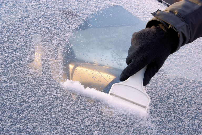 Hand Of A Man Cleaning Car In Winter
