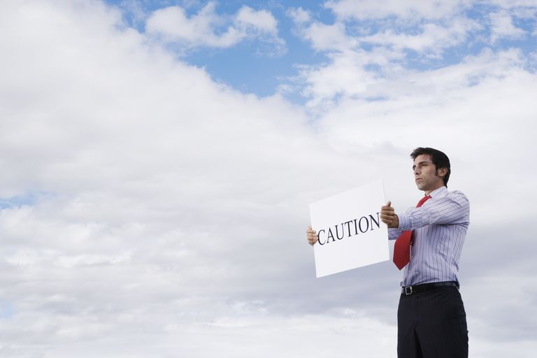 Man holding caution sign