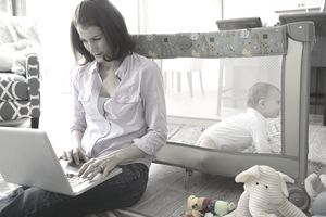 Mom With Laptop and Baby
