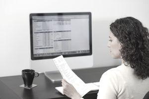 Hispanic woman paying bills on computer
