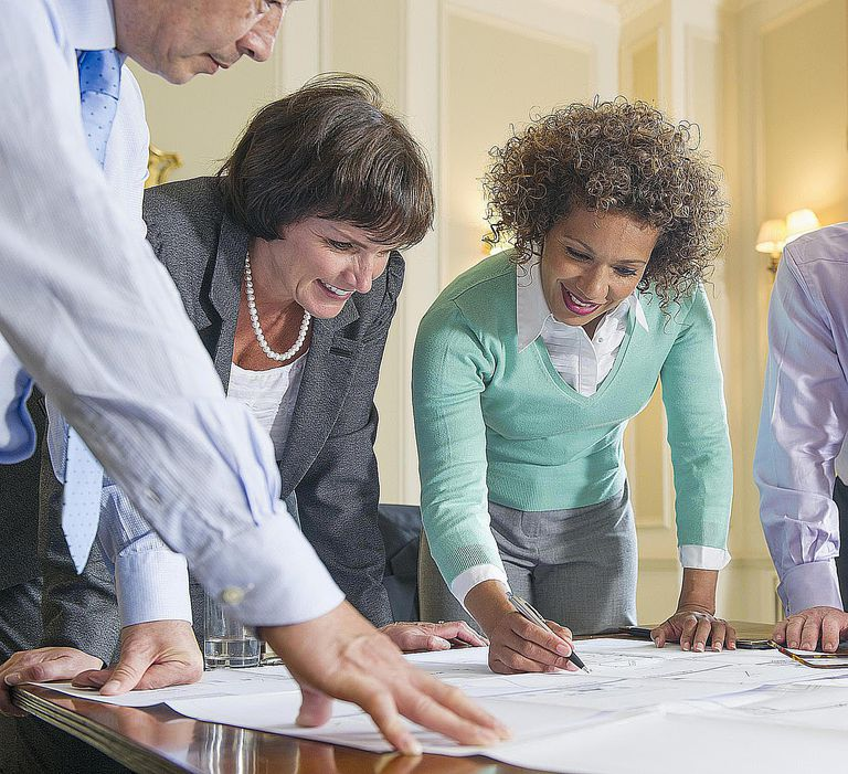 Government employees work together in a meeting. There are many public sector jobs that sociologists are qualified for.