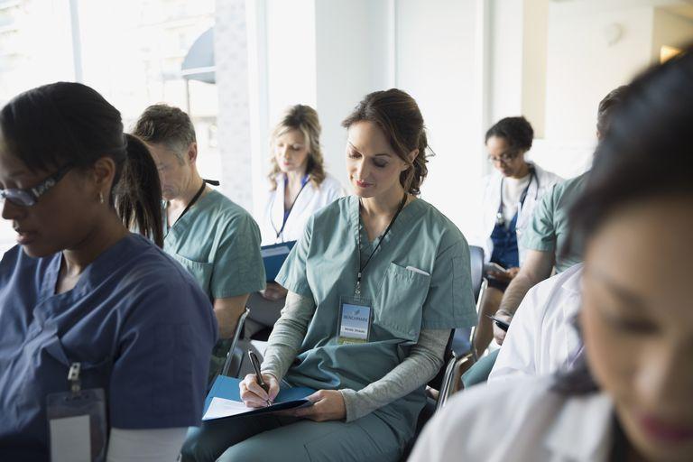 Nurse taking notes in seminar audience