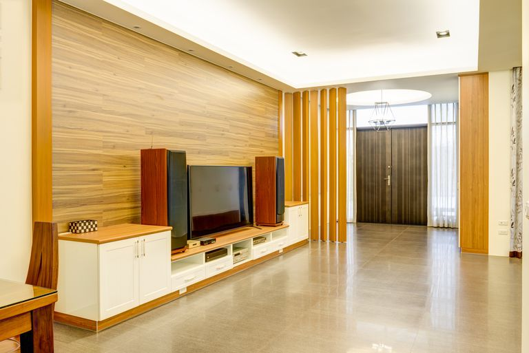 An open room with stereo speakers set up against a wall