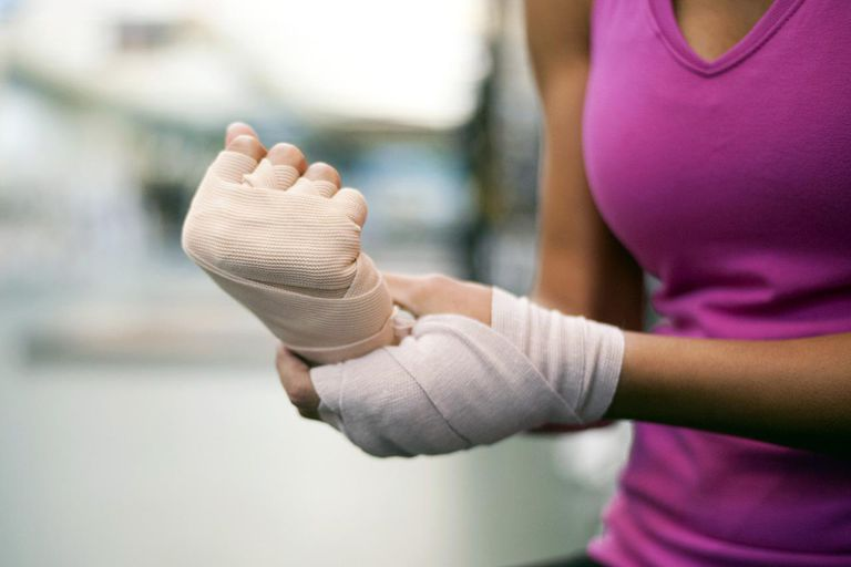 Woman with bandaged hands, cropped