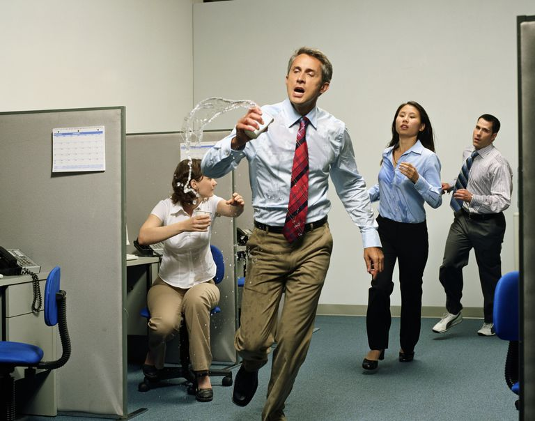 Employees demonstrating agility as they run through the office keeping up with customer needs.