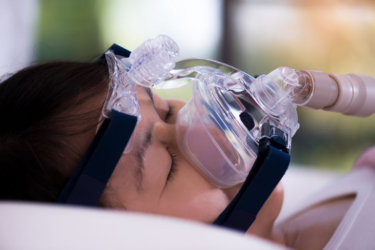 Close-Up Of Woman With Oxygen Mask