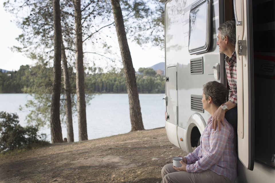 senior couple in RV looking at scenery
