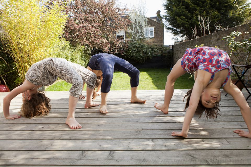 Girls Practicing Yoga on Natural Wood Deck - 149316281
