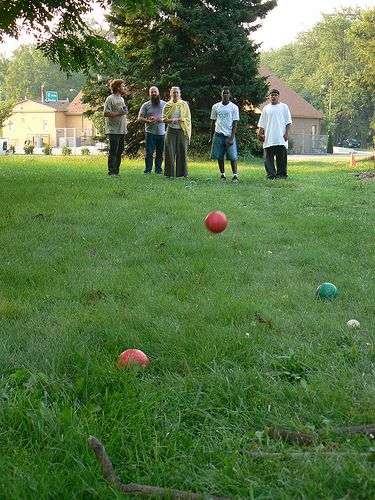 kids playing bocce ball on lawn