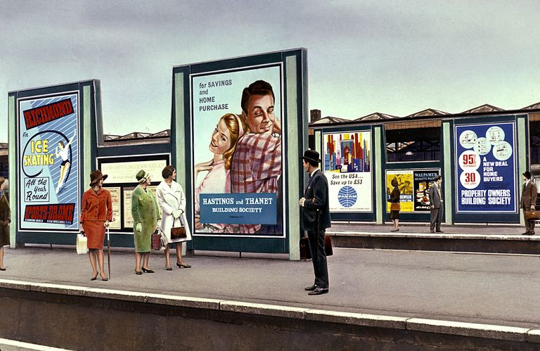 Advertisement hoardings at a London station c 1962.