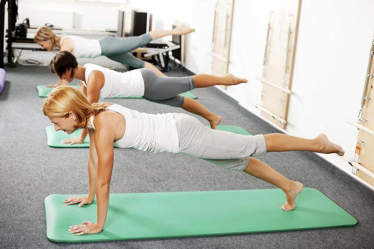 Women doing Pilates exercises.