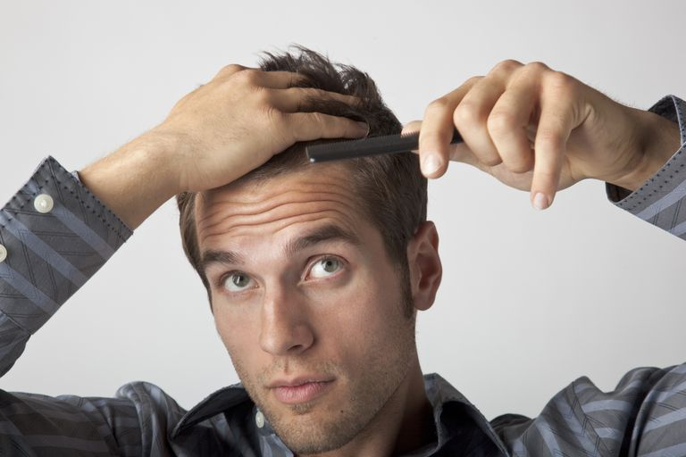 Man combing cowlick out of his hair