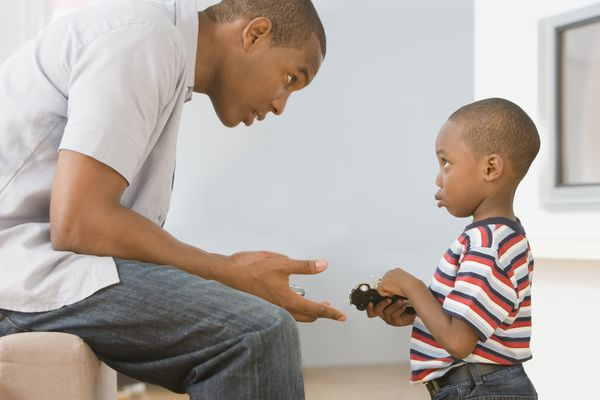 child discipline - father talking to son