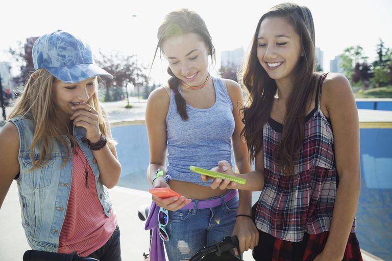 Teen girls with smartphones