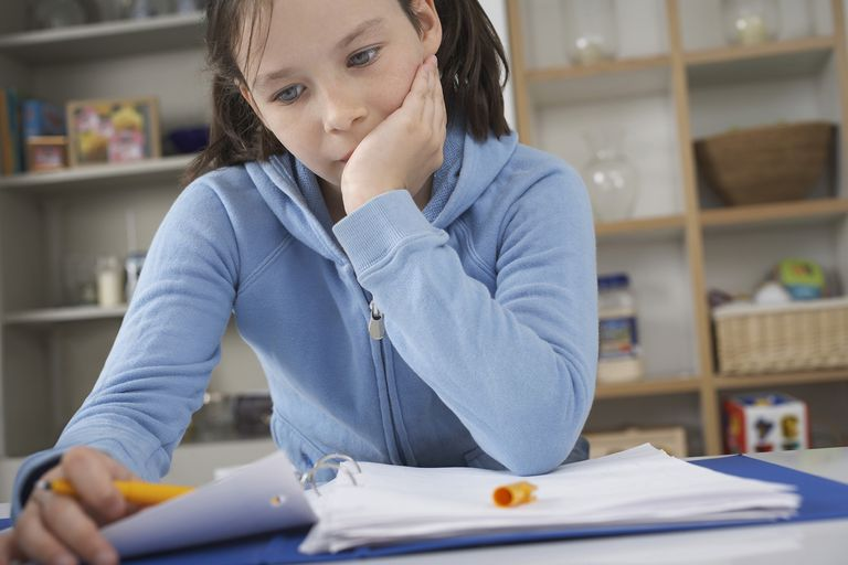 A girl struggles with schoolwork.