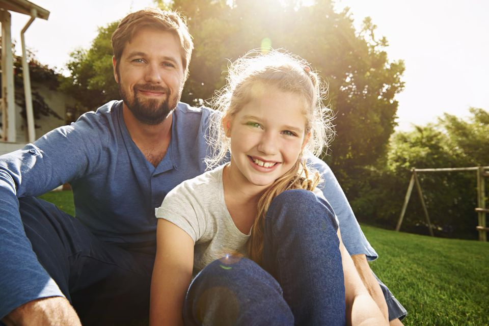 Father and daughter outdoors, portrait