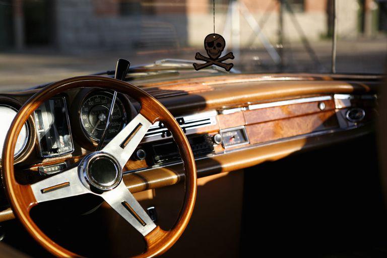A dashboard of a classic car