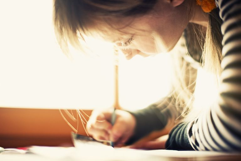 A picture of a child writing her name