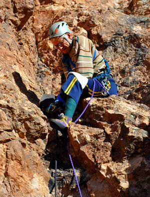 Layton Kor climbing at the Mount Nutt Wilderness Area in Arizona.