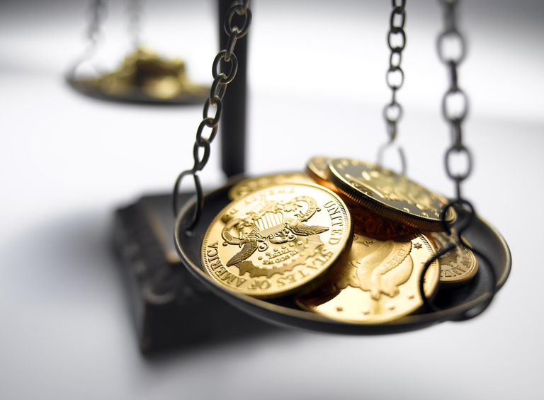 Gold coins on scale