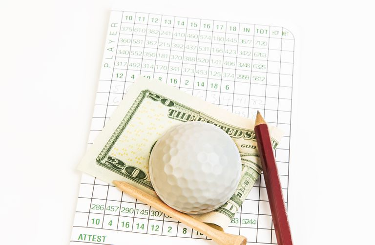 golf ball, tee, score card, pencil and paper currency
