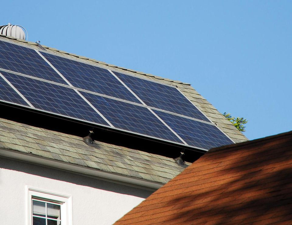 Home with solar panels on roof.