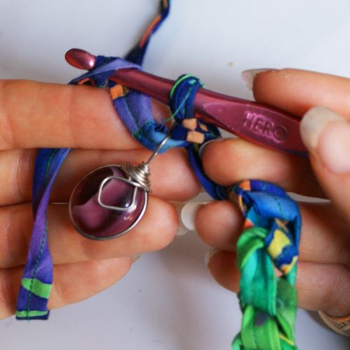Locking the First Pendant Into the Necklace by Crocheting It Into a Chain Stitch