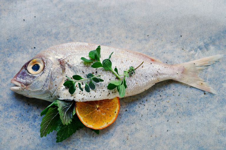 Common pandora (seabream) with orange and fresh herbs