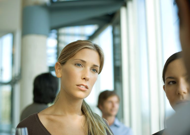 woman having serious conversation with group