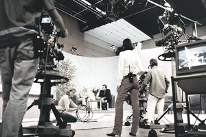 TV Presenters in a TV Studio with Producers and TV Cameraman