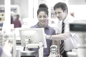 Supermarket Manager Training Cashier At Checkout