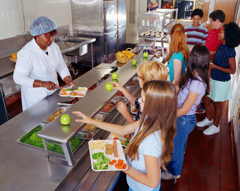 improving school lunches for kids and the environment w serving food to schoolchildren 10 13 in cafeteria