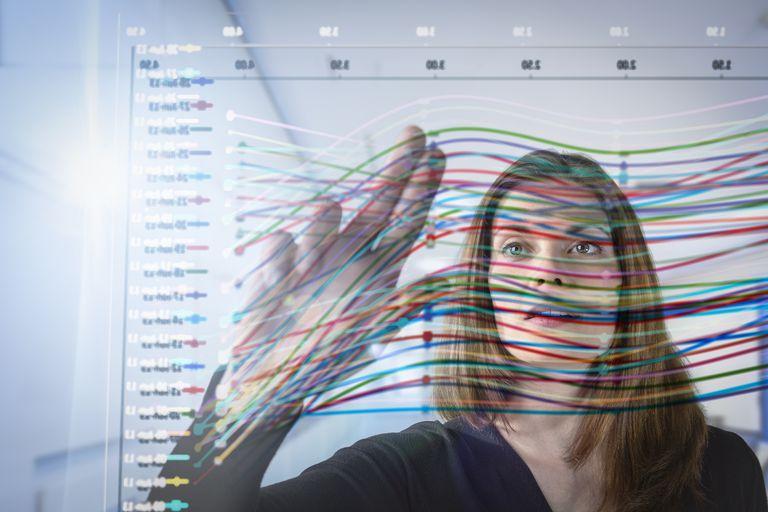 Woman looking at graph