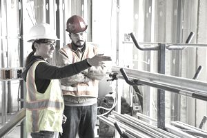 Construction workers talking at construction site