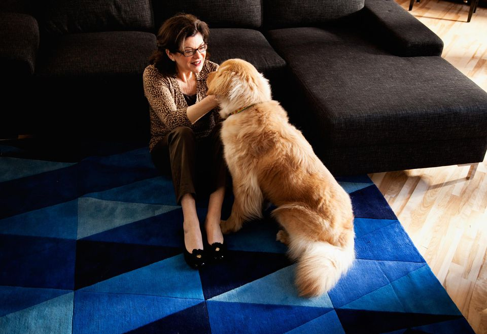 Mature woman cuddling her dog