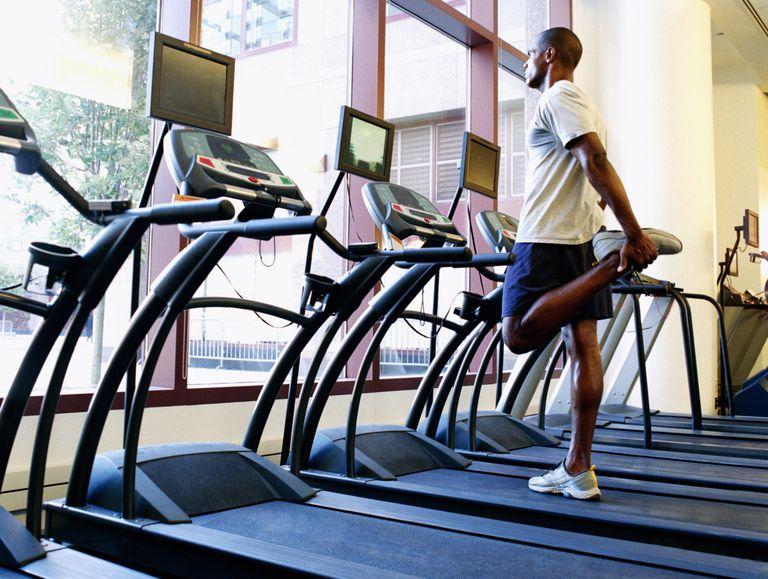 Man stretching on treadmill