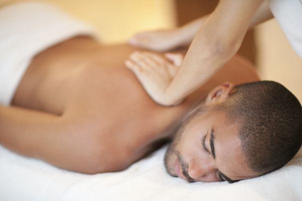 Man receiving back massage.